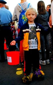 Child at Walk a Mile with a donations bucket.