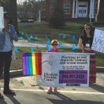 sexual assault awareness month rallyers with EFC sign and rainbow